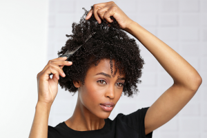 Gently detangle your curly hair from the bottom and work your way up